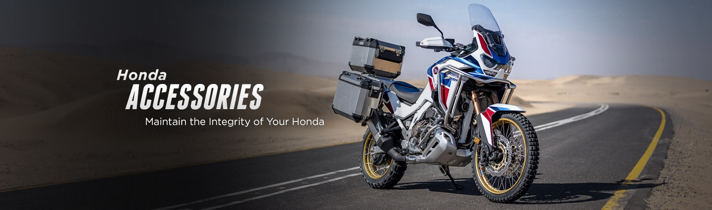 "Honda genuine parts & accessories, ""Maintain the integrity of your Honda"" quote. Image of  a Honda motorcycle on the highway."
